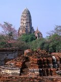 Wat Ratburana (Ratchaburana) was built in 1424 during the reign of King Borom Rachathirat II (Borommarachathirat II).<br/><br/> Ayutthaya (Ayudhya)) was a Siamese kingdom that existed from 1351 to 1767. Ayutthaya was friendly towards foreign traders, including the Chinese, Vietnamese (Annamese), Indians, Japanese and Persians, and later the Portuguese, Spanish, Dutch and French, permitting them to set up villages outside the city walls. In the sixteenth century, it was described by foreign traders as one of the biggest and wealthiest cities in the East. The court of King Narai (1656–1688) had strong links with that of King Louis XIV of France, whose ambassadors compared the city in size and wealth to Paris.